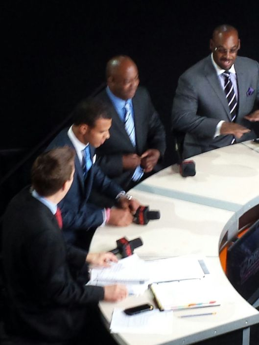 New Edmonton Oiler Darnell Nurse (second on left) does TV interview with uncle Donovan McNabb (far right)