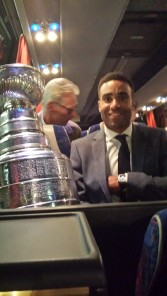 Oduya shares a bus ride with Lord Stanley in Sweden. (Phil Pritchard, HHOF).