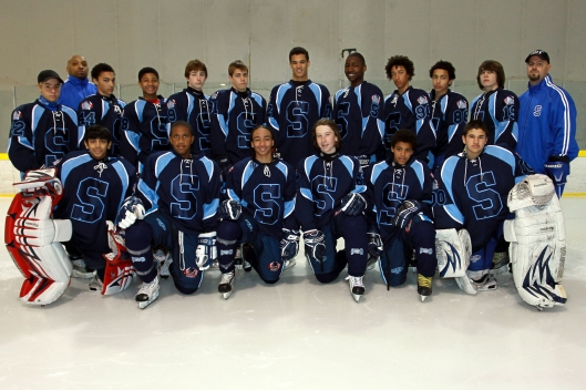 Skillz Black Aces Coach Cyril Bollers, rear left, and his 2010  team.