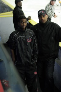 Coach Cyril Bollers, right, with Josh Burnside, who now plays for the OHL Mississauga Steelheads.