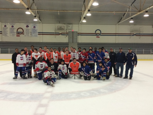 kids and coaches from the Ed Snider Youth Hockey Foundation, Ice Hockey in Harlem and Philly's Wissahickon Skating Club at a recent tournament.