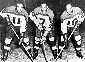 The Black Aces: Herb Carnegie, center, Ossie Carnegie, right, and Manny McIntyre.