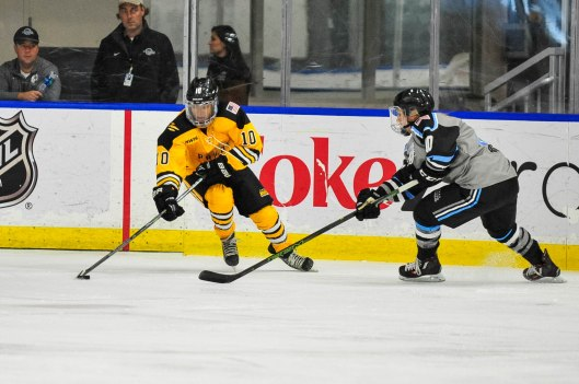 Boston Pride defenseman Blake Bolden, left, calls the Women's Classic outdoor game between NWHL and CWHL teams a boost for women's hockey (Photo/NWHL).