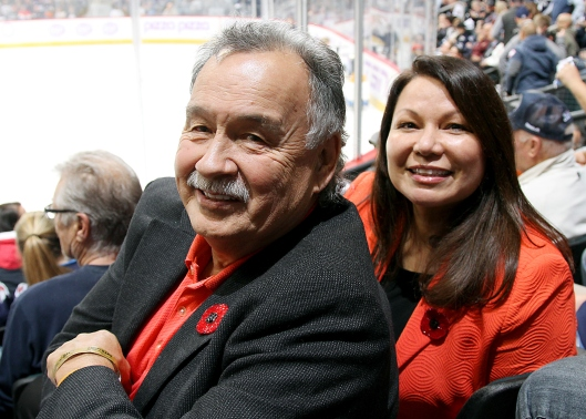 Reggie Leach and his wife, Dawn, recently taking in a hockey game in Winnipeg.