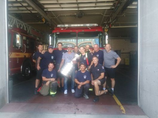 Trevor Daley and Lord Stanley hanging out at the firehouse on Daley's day with the Stanley Cup (Photo/Phil Pritchard/Hockey Hall of Fame).