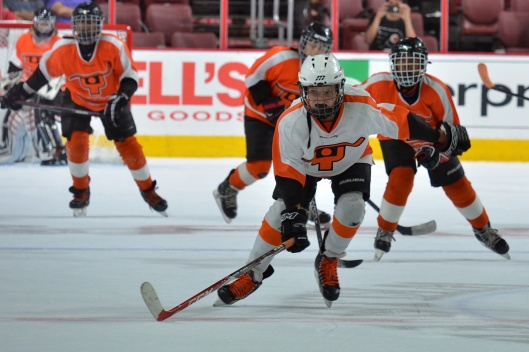 Ed Snider Youth Hockey Foundation players hope to win the #GiveTuesday challenge against Ice Hockey in Harlem - and avoid having to wear New York Rangers gear.